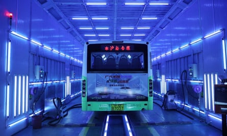 A bus is being disinfected by ultraviolet light in Shanghai