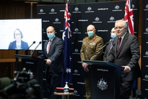 Prime Minister Scott Morrison at a press conference with the Treasurer Josh Frydenberg, CMO Paul Kelly and head of the Covid 19 task force Lieutenant General John Frewen in the main committee room of Parliament House