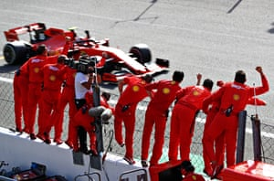 Race winner Charles Leclerc is greeted by his team on the pit-wall.