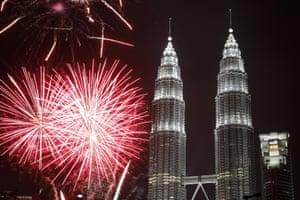 Fireworks explode in front of the Petronas twin towers in Kuala Lumpur, Malaysia