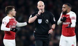 Arsenal's Alexandre Lacazette (right) exchanges words with match referee Anthony Taylor.