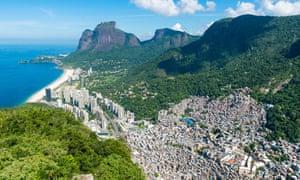 The view from above Sao Conrado Beach with Pedra da Gavea mountain and the favela community of Rocinha.