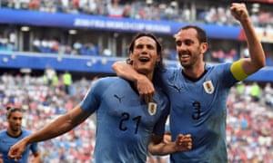 Uruguay's Edinson Cavani celebrates with Diego Godin after scoring the third goal.