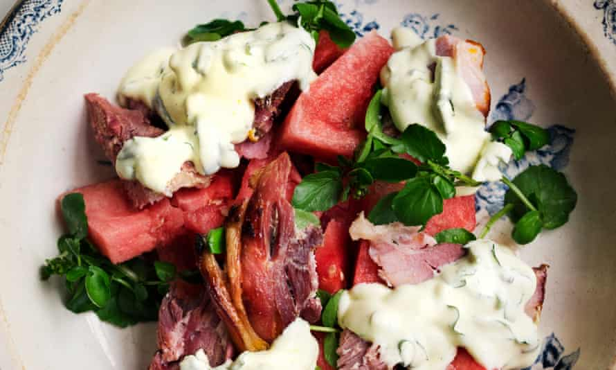 Ham, watermelon and basil piled on a plate