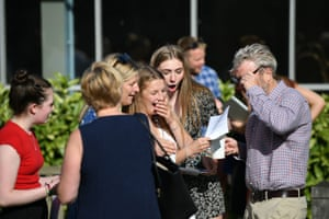 Kitty Taylor (centre left) shares her delight with her parents and Amy Barker at Norwich school in Norfolk