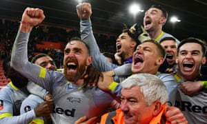 The Derby players celebrate after Richard Keogh's winning penalty put Frank Lampard's side through.