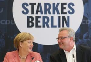 The German chancellor Angela Merkel with CDU candidate Frank Henkel earlier this year.