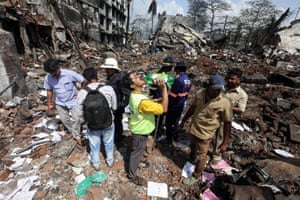 People inspect the damage after a blast at a chemical factory on the outskirts of Mumbai