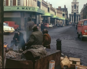 Spitalfields Market, 1973Men stay warm around a fire of vegetable boxes. 'It's one of Granick's few pictures that made direct social comment about the desperate poverty in the East End,' says Dorley Brown