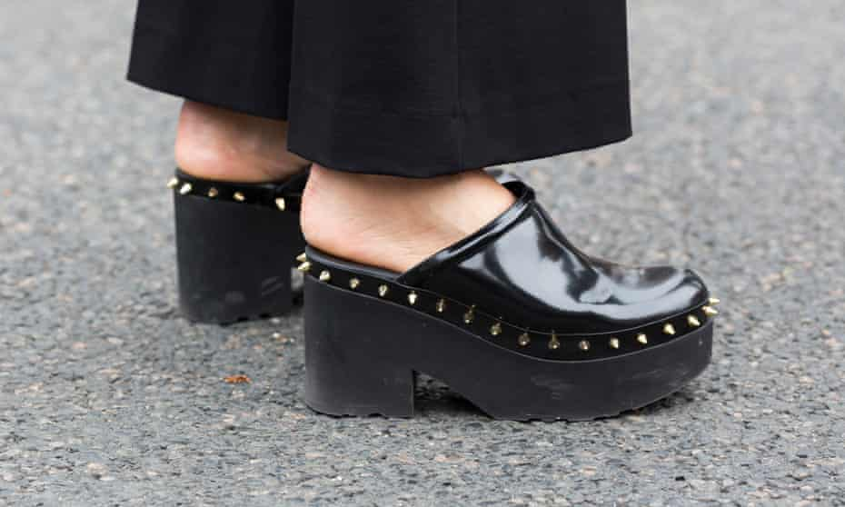 a pair of clogs in the wild and Paris fashion week.