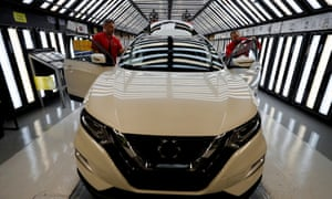 Workers are seen on the production line at Nissan's car plant in Sunderland.