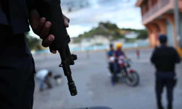 Police patrol a gang-ridden area of Tegucigalpa, the Honduran capital.