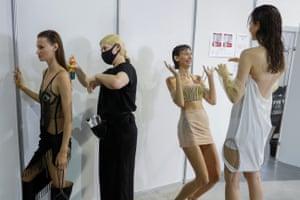 Kiev, UkraineA model has her hair sprayed while others share a joke backstage at Ukrainian Fashion Week