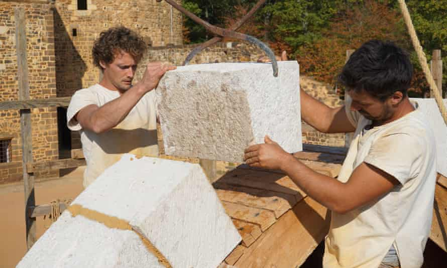 Workers moving blocks of stone at Guédelon