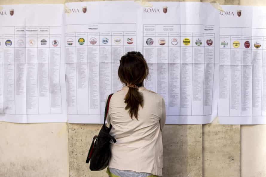 A woman studies candidate lists for the municipal elections.