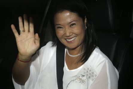 Keiko Fujimori waves as she arrives in a car to the hospital where her jailed father was admitted after suffering a drop in blood pressure.