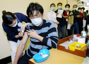 Poultry workers in Hong Kong being vaccinated during the 2004 bird flu crisis.