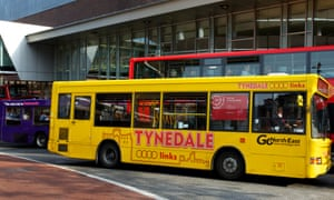 Blue, yellow and red buses at Haymarket bus station, Newcastle, in 2013