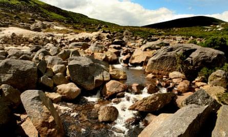 The river Liffey flows through the Wicklow mountain range in Ireland.
