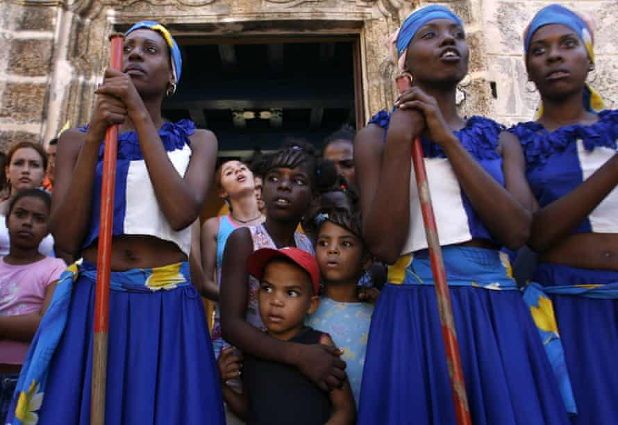 Dancers in colorful costumes perform in a street in Havana, a tradition established in colonial times that gave slaves one day a year to freely celebrate in the streets with dance and drums.