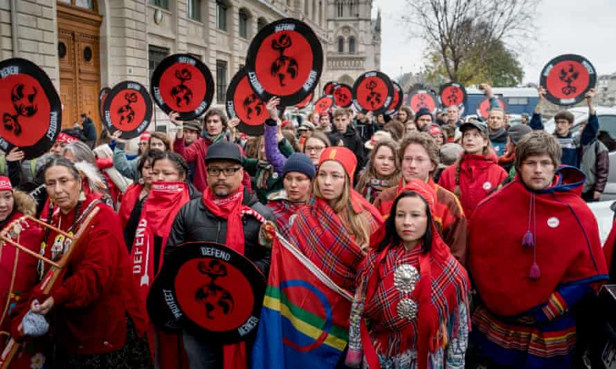 Indigenous activists lead the Red Lines action in Paris at the end of the UN climate negotiations on December 12, 2015.