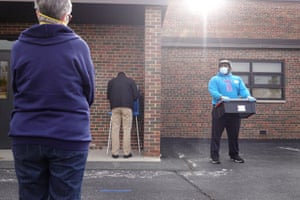 A resident casts a ballot outside of Roosevelt Elementary School in Racine, Wisconsin.