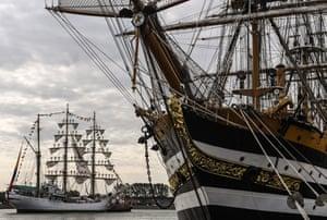 Rostock-Warnemünde, Germany: The Colombian vessel Gloria passes the Italian tall ship Amerigo Vespucci during the Hanse Sail maritime festival