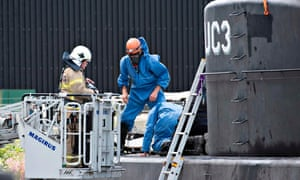 Police inspect Peter Madsen's submarine UC3 Nautilus in Copenhagen harbour after journalist Kim Wall's disappearance.