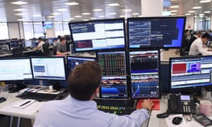 A trader at IG Group Holding looks at computer screens in central London on Tuesday as European shares rebounded after worries about the outlook for China's economy led to massive sell-off on Monday.