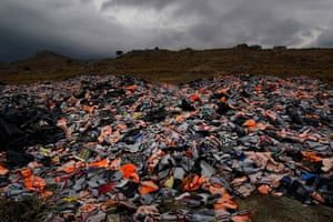 Life jackets and rubber boats abandoned by migrants  from Turkey on the Greek island of Lesbos.  Authorities have begun to relocate refugees to the mainland to ease pressure on the island.