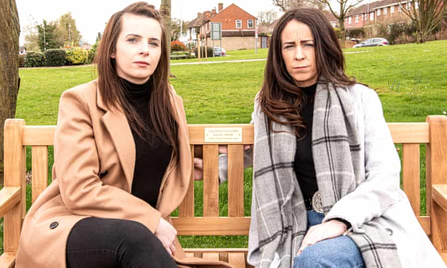 Claire and Lauren Holmes on a bench installed in their sister Collette's memory.