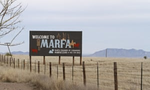 A welcome to Marfa sign is posted off of Highway 90.