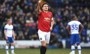Harry Maguire celebrates opening the scoring for Manchester United at Tranmere.