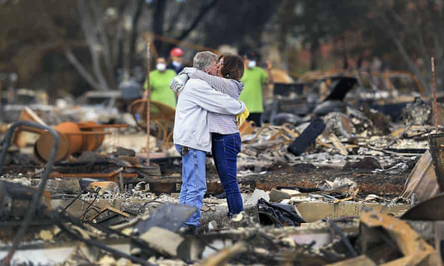Gordon Easter and Gail Hale embrace as they return to what remains of their home on Hopper Lane in Coffey Park, in October 2017 in Santa Rosa, Northern California, after a wildfire.