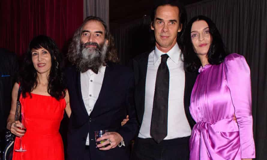 Warren Ellis with his wife Delphine and Nick Cave with his wife Susie Bick in 2017.