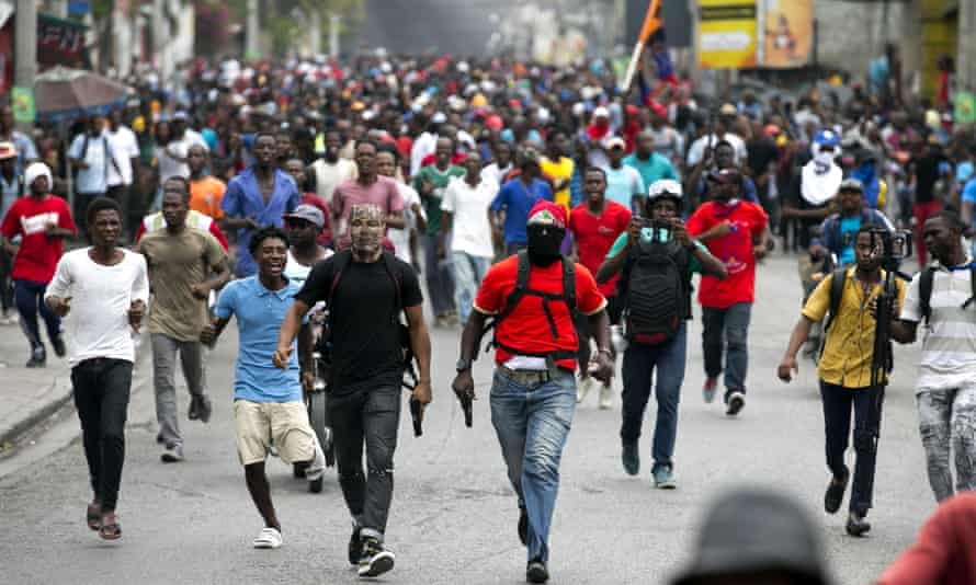 Armed off-duty police officers protest over pay and working conditions in Port-au-Prince, Haiti, on 23 February.