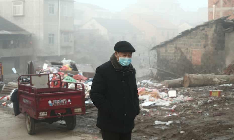 A man wearing a medical mask walks in Hubei province amid the coronavirus lockdown