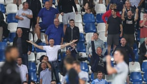 The travelling Everton fans show their disappointment towards their players at full-time.