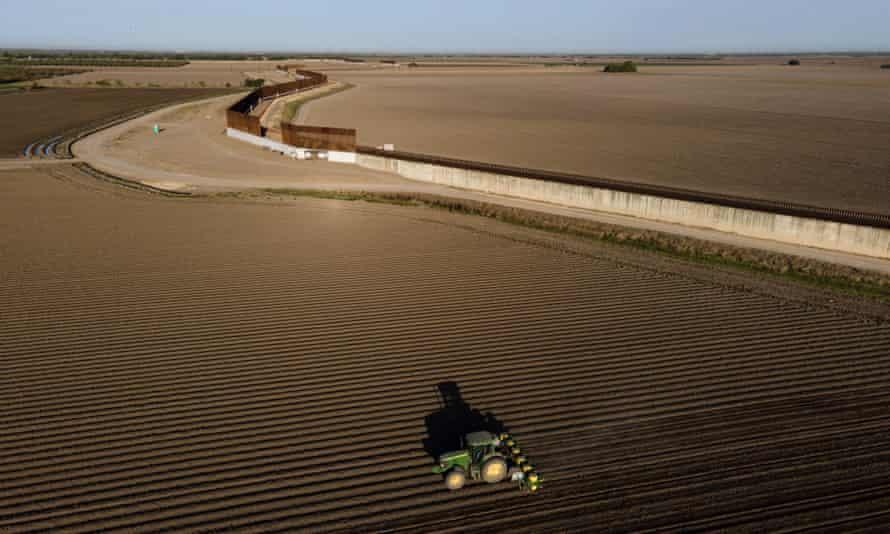 Border wall construction near farmland in Progreso, Texas.