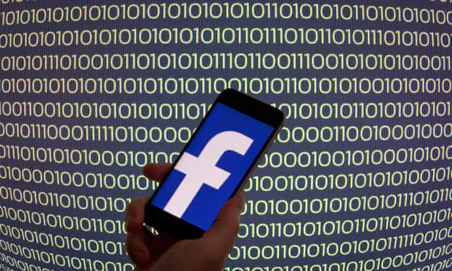 Facebook logo on mobile phone
