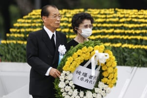 Visitors carry flowers for the victims