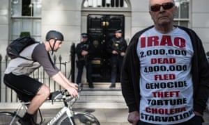 Protester Michael Culver, 78, wearing an Iraq t-shirt stands outside the London home of Tony Blair.