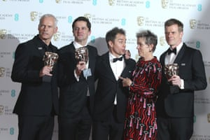 Director Martin McDonagh, producer Peter Czernin, Sam Rockwell, Frances McDormand and producer Graham Broadbent pose for photographers backstage with their best film awards for Three Billboards Outside Ebbing, Missouri