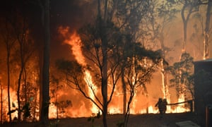 More than 60 bushfires are burning across New South Wales, including the 180,000-hectare fire at Gospers Mountain, in Sydney's north-west.