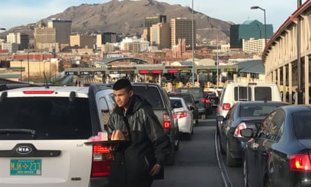 Street vendor serves traffic on the Puente de las Americas as drivers from Juarez wait to cross the border and enter El Paso