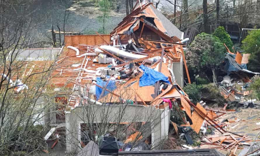 A house is left missing a roof after a tornado passed through the Eagle Point subdivision in Hoover, Alabama.