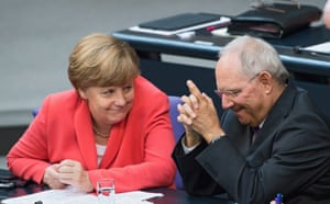 German Chancellor Angela Merkel (L) and German Finance Minister Wolfgang Schaeuble during a special session of the German Bundestag over the proposed bailout package for Greece, in Berlin, Germany, 17 July 2015.