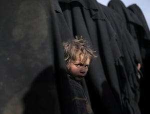 A boy looks at the camera near Baghouz, Deir Al Zor province