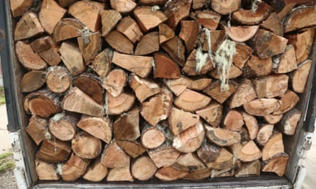 Firewood in a truck, downtown Coyhaique. Air pollution in Coyhaique, Chile, casued by burning wet firewood. A scheme is in place for people to exchange their wood burners which emit 8-16 grammes of fine particles per hour for cleaner pellet stoves