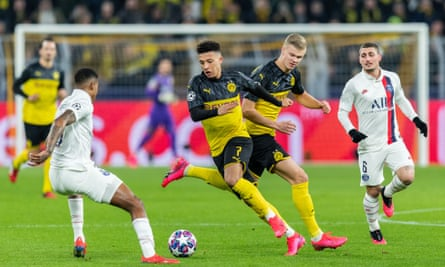 Jadon Sancho (centre left) and Erling Haaland (centre right) in action against PSG in February 2020.